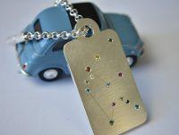 Goldschmied Herrenberg, Schlüsselanhänger in Silber mit farbigen Brillanten
