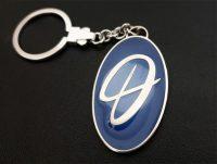 Schlüsselanhänger Silber mit Feinlackierung nach Kundenwunsch